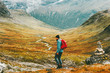 Man backpacker hiking in north mountains with backpack Travel sport lifestyle concept active weekend summer vacations wild nature in Scandinavia