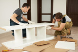 Two carpenters assembling furniture - 183766479