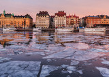 Winter image from Stockholm city with old boats and buildings. - 183767445