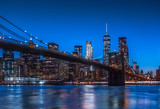 New York City Panoramic landscape view of Manhattan with famous Brooklyn Bridge at dusk . - 183774229