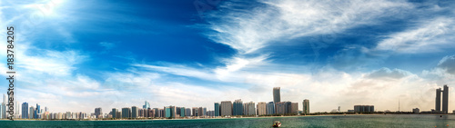 Plexiglas Abu Dhabi Abu Dhabi, UAE. Panoramic cityscape view at sunset from Marina viewpoint