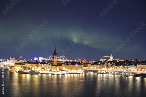 Plexiglas Stockholm Scenic night panorama of the Stockholm with visible northern lights, Sweden