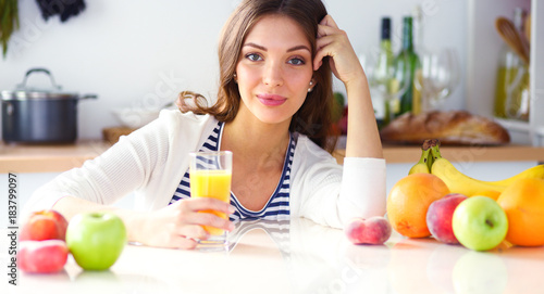 Foto op Canvas Sap Portrait of a pretty woman holding glass with tasty juice