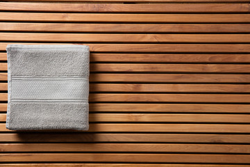 Concept for shower or spa with towel over wooden board © STUDIO GRAND WEB