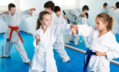 Smiling children sparring in pairs