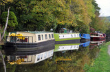 barges and houseboats moored along the rochdale canal near hebden bridge in west yorkshire - 183815229