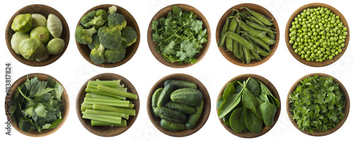 In de dag Verse groenten Green vegetables and herbs isolated on a white background. Squash, brocoli, green peas, cucumbers and leaves parsley, celery, cilantro, spinach in wooden bowl with copy space for text. Top view.