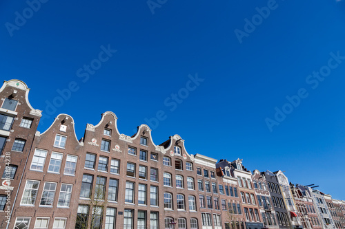 Poster Amsterdam Historical Amsterdam canal houses in a blue sky.
