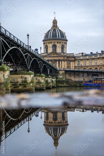 River Seine with Pont des Arts and Institut de France at night in Paris