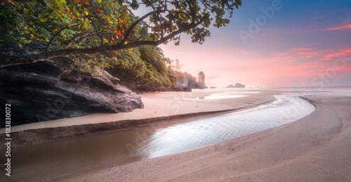 Foto op Canvas Lichtroze Tropical beach at sunrise