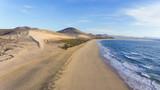 Aerial view of white sand beach, dunes, mountain panorama, Jandia, Costa Calma, Fuerteventura, Canary Islands . - 183831857