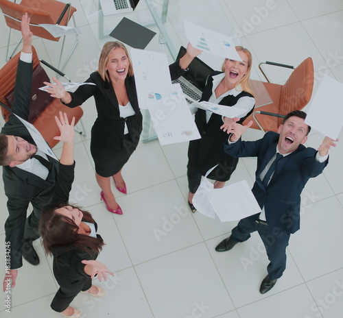View from the top: happy business team celebrating their win