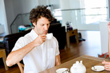 Man having tea at home