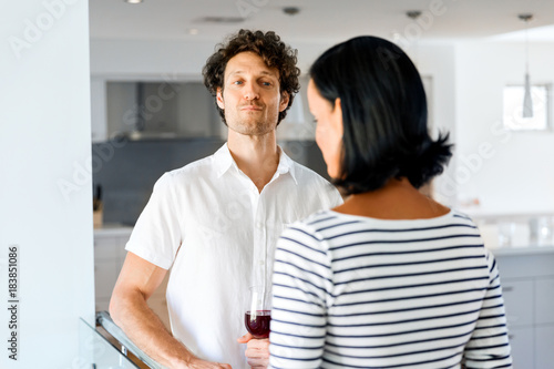 Young man listening to woman