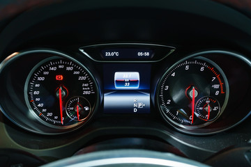 Modern light car mileage (dashboard, milage) isolated on a black background. New display of a modern car. RPM, Fuel indicator and temperature. Fuel economy.