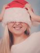 Woman wearing Santa hat that covers her eyes