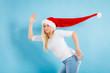 Woman wearing windblown santa hat