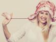 Woman wearing winter furry warm hat