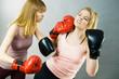 Two agressive women having boxing fight