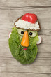 Santa Claus made with salad, bread and cheese - 183883411