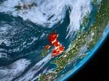 Orbit view of United Kingdom at night - 183888424