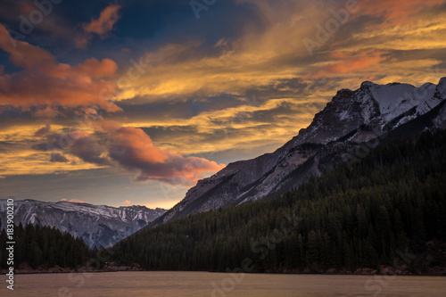 Dramatic orange and red clouds amongst the mountains at sunrise