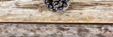 Black olives on a wooden background. View from above