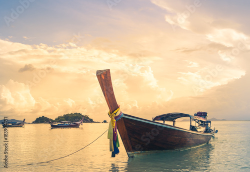 Tuinposter Beige long tailed boat, fishing boat, motor boat on the sunset scene