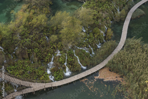 View from above of wooden path through the lake with a lot of beautiful cascades in Plitvice National Park, Croatia - 183908244