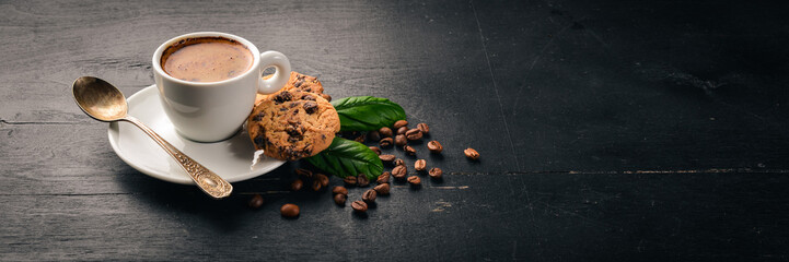 Coffee and oatmeal chocolate cookies on a wooden background. Coffee beans. Top view. Free space for text. © Yaruniv-Studio