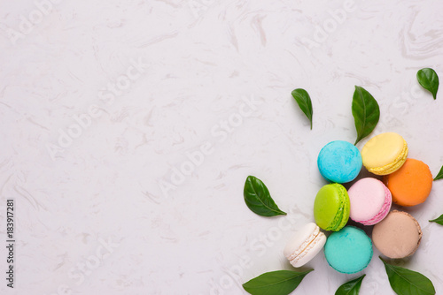 Fotobehang Macarons Sweet colorful macarons on marble stone background with copy space