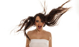 young happy woman with flying hair on white background - 183917444