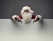 Santa Claus pointing at blank sign