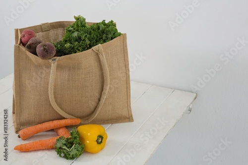 Fresh vegetables in grocery bag