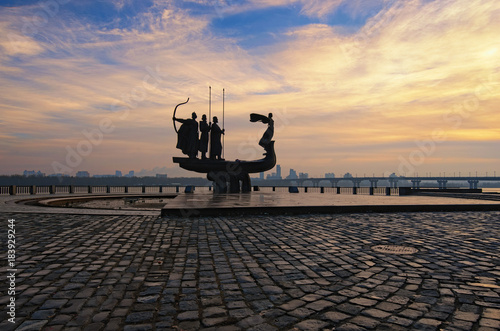 Poster Kiev Monument to Founders of Kyiv, the capital of Ukraine against Patona Bridge and cityscape background. Sunrise at winter season