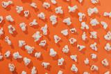 Fototapety Popcorn on an orange background