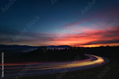 Light line of traffic on highway before sunrise | Buy Photos | AP
