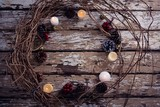 Lit candles and christmas decoration on wooden plank - 183940479