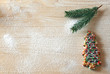 Greeting card with Christmas tree cookie on wood