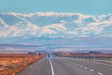 A long straight road leading towards a Toros mountain - 183955484