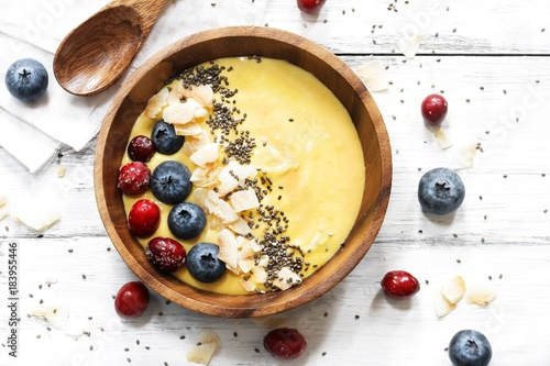 Overhead view of Breakfast mango smoothie bowl / Healthy eating concept
