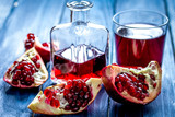 red fruit juice with fresh pomegranate on wooden background - 183959035