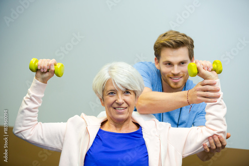 Poster senior female working with physiotherapist