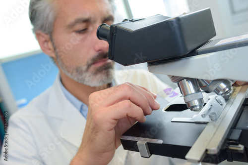 Man using microscope - 183961035