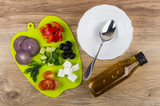 Ingredients for greek salad on cutting board, bowl, spoon, oil - 183963272