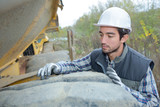 Worker by cement lorry - 183965660