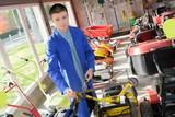 Young man in gardening machinery store - 183965699
