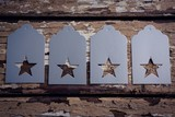 Tags with star shape on wooden plank - 183966006
