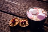 Cookies and hot chocolate on wooden plank - 183966899