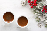 Two cups of coffee and fir branch with Christmas decorations on old wooden shabby background. - 183967441